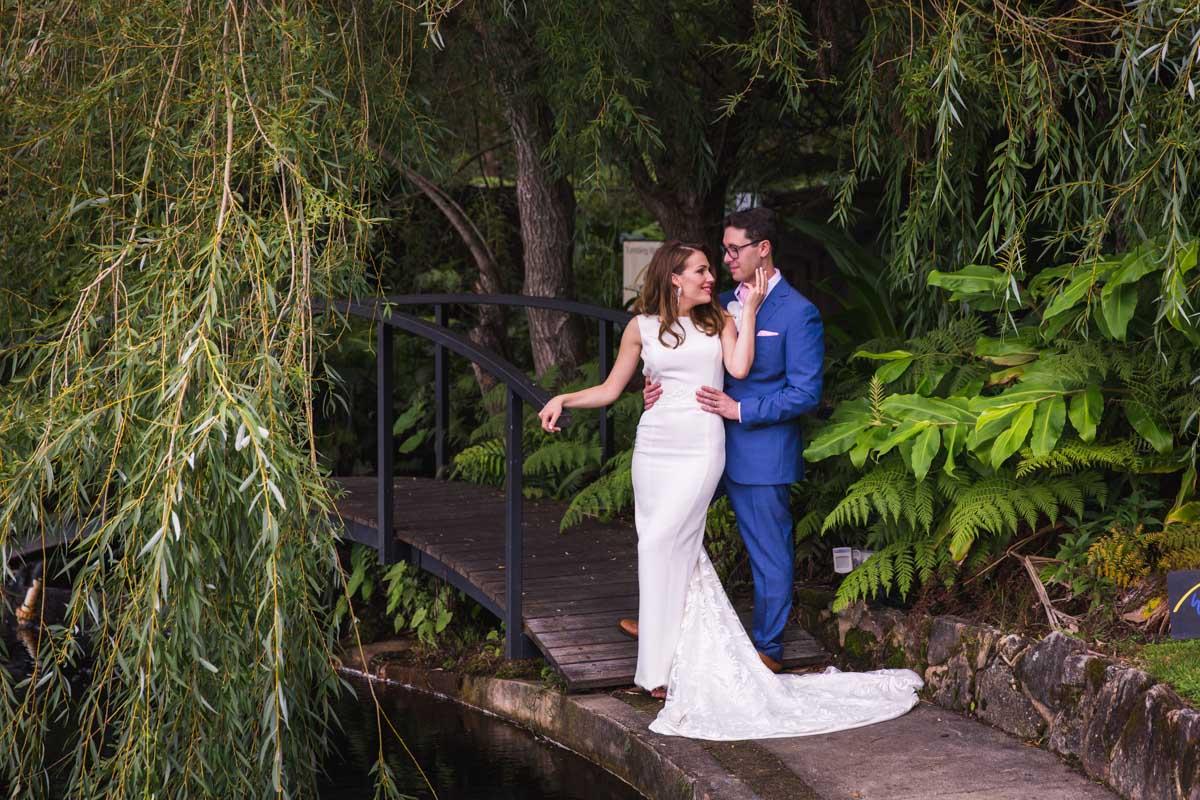 Tumbling waters wedding photograph of bride and groom on bridge in wollongong
