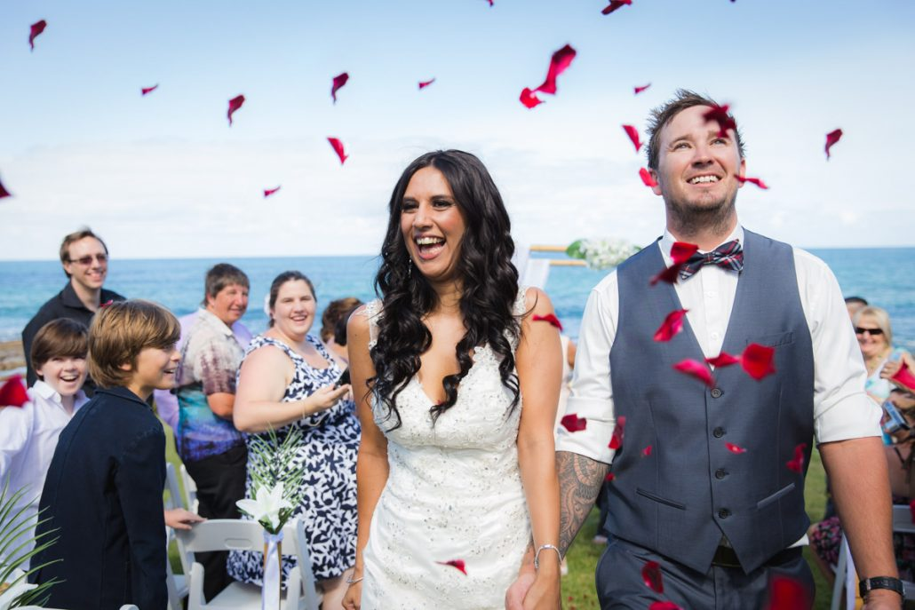 Rose petals throwing at wedding on the beach