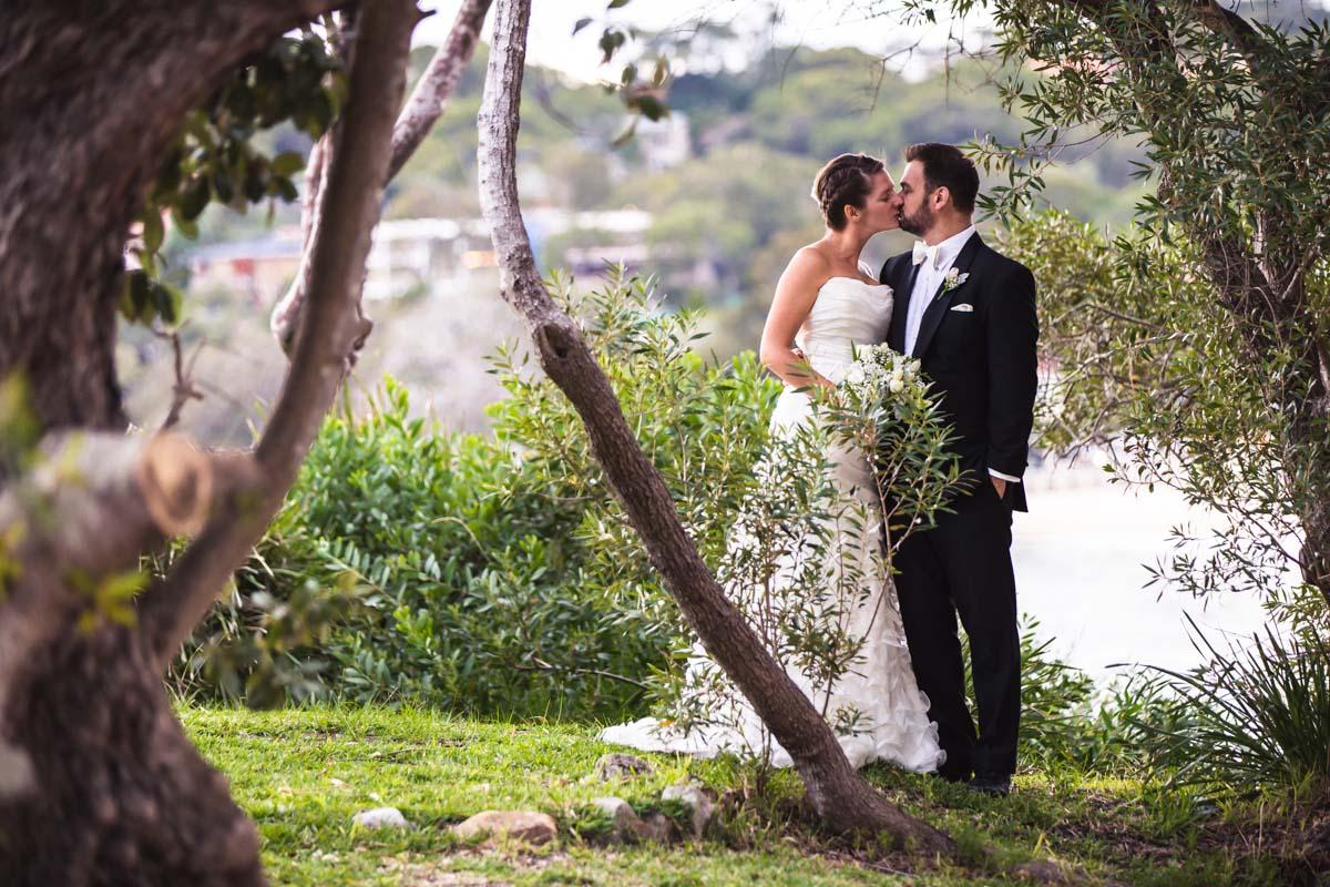 Bride and Groom kissing at Balmoral Beach