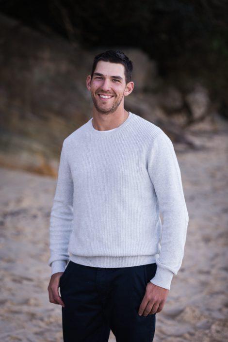 portrait of groom on the beach