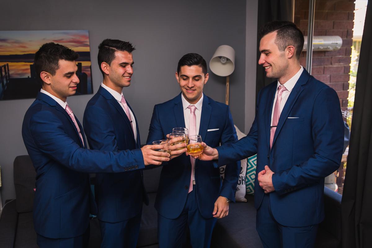 boys having a drink before wedding