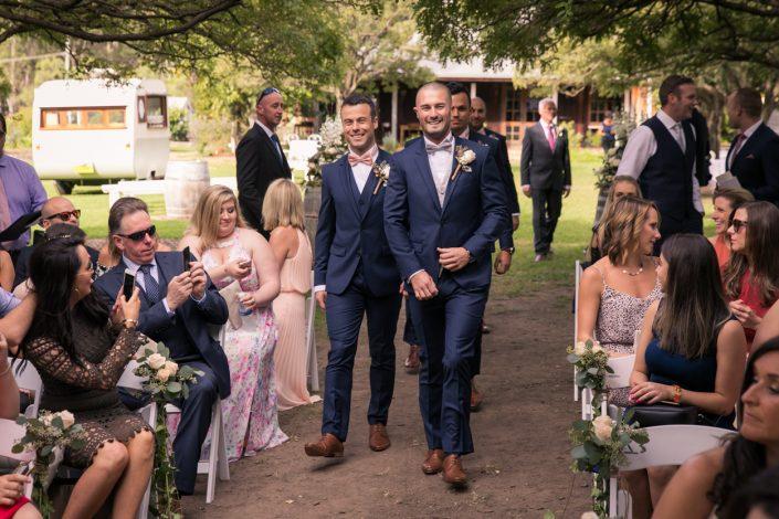 groomsmen walking down aisle