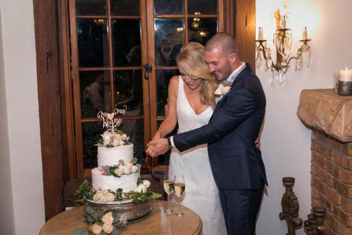 husband and wife cutting cake
