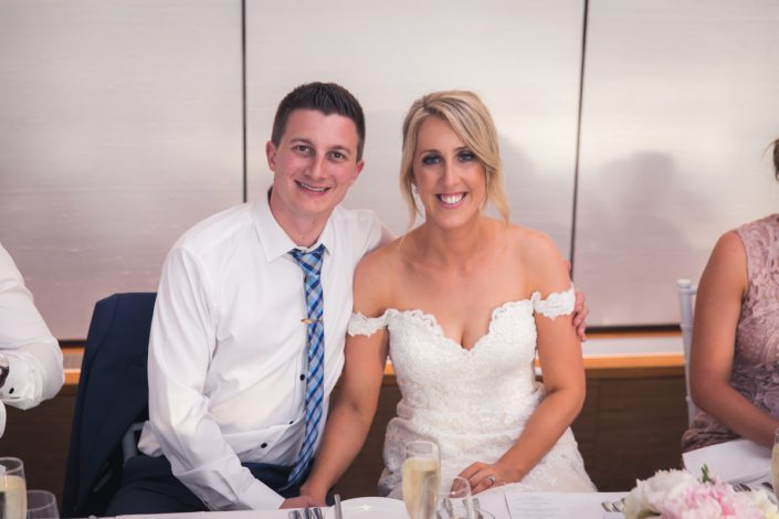 bride and groom at wedding table