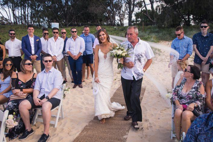 bride walking down the aisle at wedding