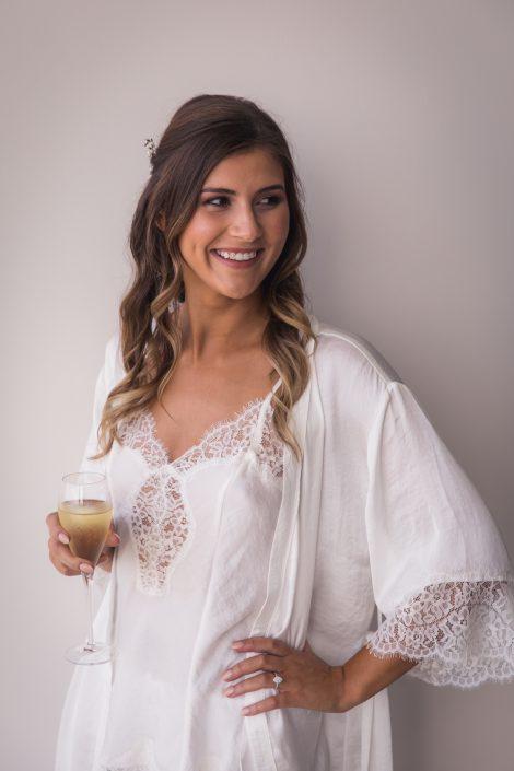 portrait of bride in her robe before wedding