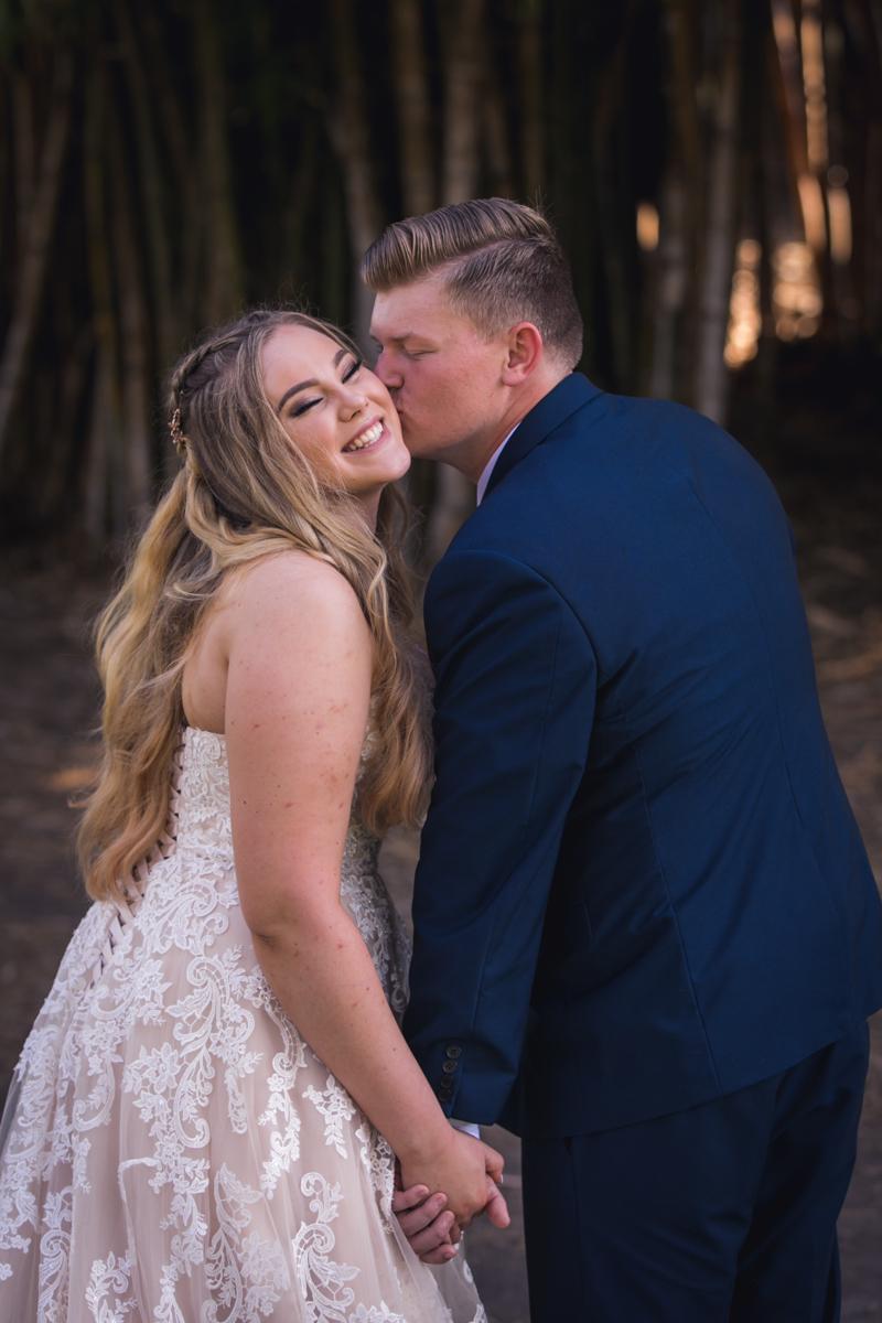 kiss on cheek at wedding
