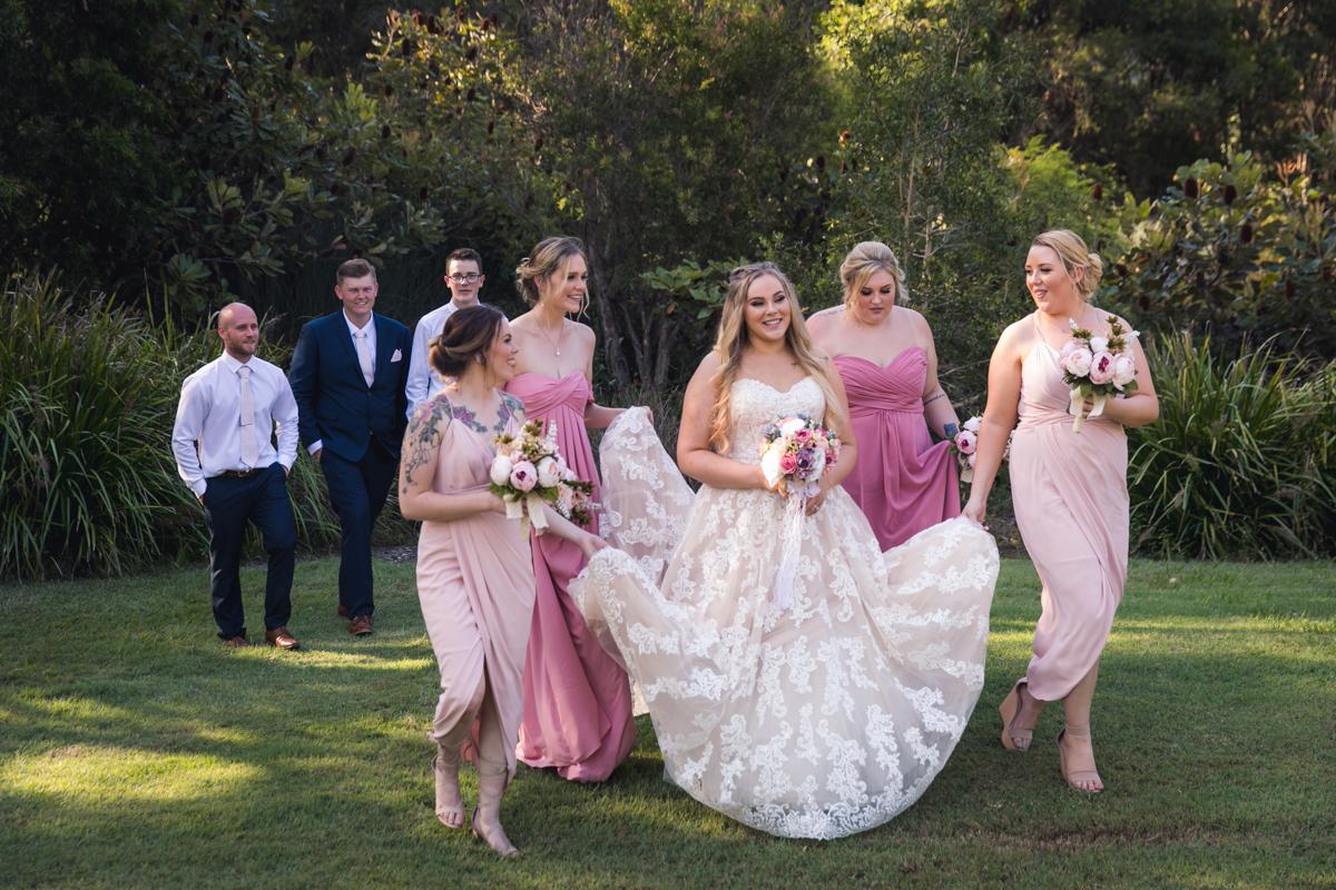 bridesmaids carrying dress
