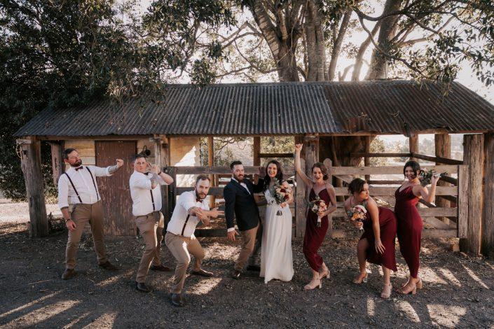 bridal party acting silly at wedding