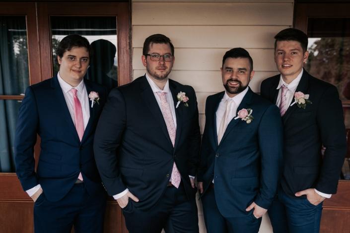 nice group photo of groomsmen before wedding
