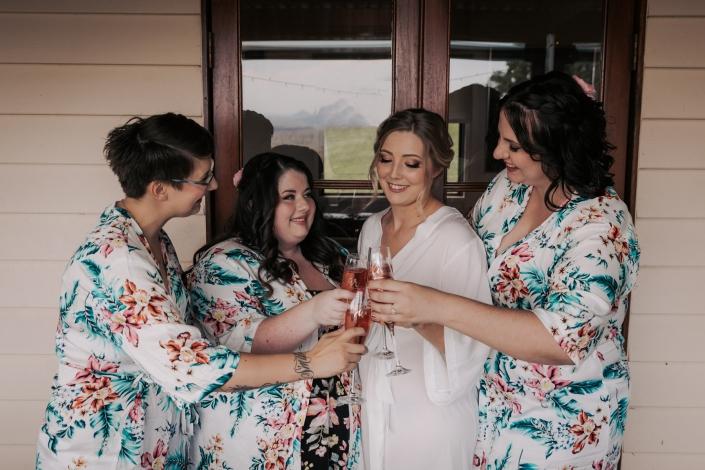 bridesmaids having a drink before wedding