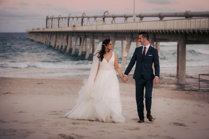 husband and wife on beach