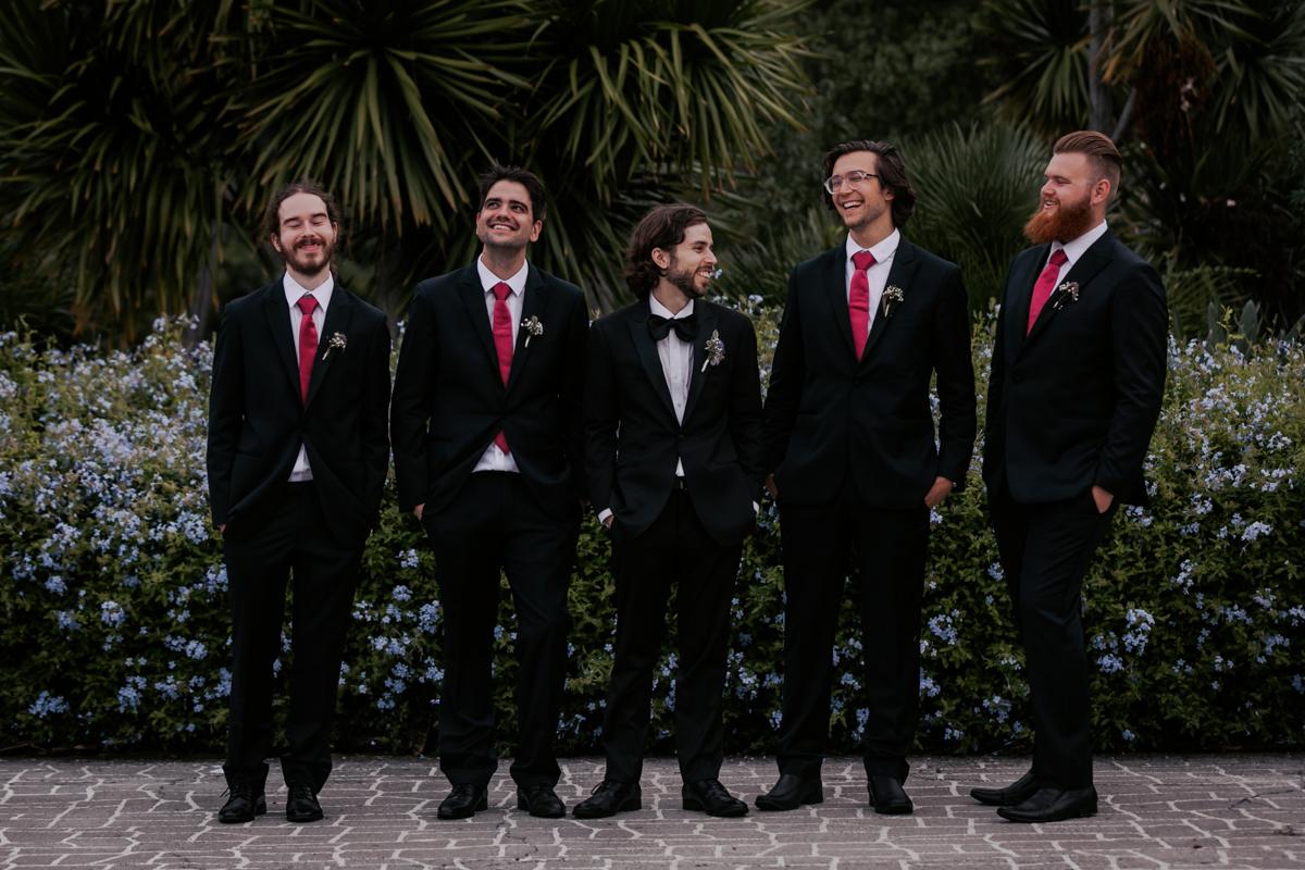groomsmen talking at wedding